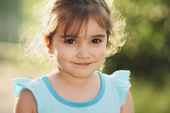 Little girl in blue dress Royalty Free Stock Photography