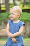 Little girl in blue dress Stock Images
