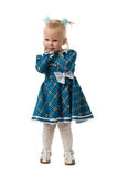 The little girl in a blue dress. The little girl in a blue chequered dress Stock Image
