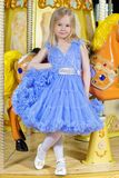 Little girl in blue dress Royalty Free Stock Images