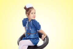 The little girl in the blue dress. Stock Photography