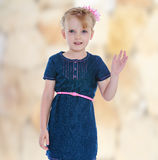 Little girl in a blue dress Stock Photography