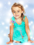 Little girl in blue dress on her knees Stock Image