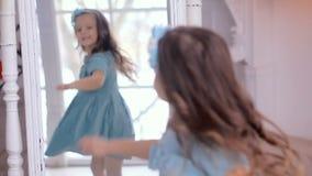 Little girl in blue dress looking stock footage