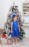 Little girl in a  blue dress  near Stock Image