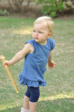 Little girl in blue dress in park Royalty Free Stock Photo