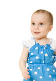 Little girl in blue dress smiling Stock Photos