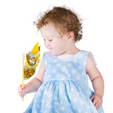 Little girl in a blue dress with a wind toy Royalty Free Stock Images