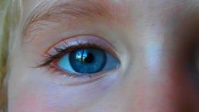 Little girl blue eye video. Macro of a reflection in a little girl eye movie stock video
