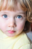 Little girl with blue eyes Stock Photos