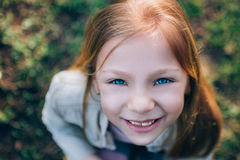 Little Girl With Blue Eyes Stock Image
