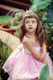 Little girl with blue eyes. In pink dress in the garden Royalty Free Stock Images