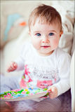 Little girl with blue eyes sitting in the crib Stock Photos