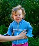 Little girl in blue on female hands Royalty Free Stock Image