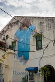 Little Girl in Blue. GEORGETOWN PENANG, MALAYSIA - November 26, 2017: Little Girl in Blue street art mural by Lithuanian artist Ernest Zacharevic in GeorgeTown Stock Photo