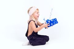 Little girl with blue gift Stock Images