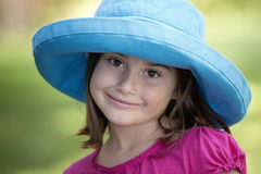 Little girl in blue hat Stock Image