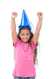 Little girl with blue hat holding up her arms Stock Image
