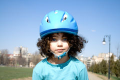 Little girl with blue helmet Royalty Free Stock Photo