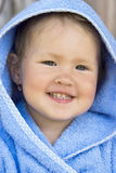 Little girl in  blue hood Stock Photo