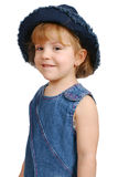 Little girl in blue jeans dress Royalty Free Stock Photo