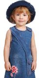 Little girl with blue jeans hat and dress Royalty Free Stock Photos