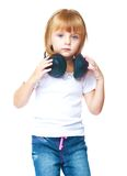 Little girl in blue jeans. Royalty Free Stock Image