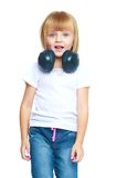 Little girl in blue jeans stock image