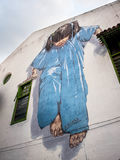 Little Girl in Blue Mural in Georgetown, Penang, Malaysia. Little Girl in Blue street art mural by Lithuanian artist Ernest Zacharevic in George Town, Penang Royalty Free Stock Images