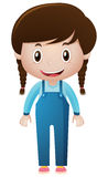 Little girl in blue overall Stock Images