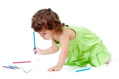 Little girl with blue pencil Stock Photos