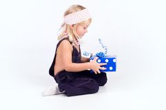 Little girl with blue present Stock Photos