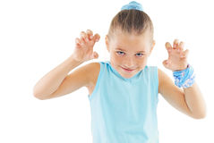Little girl in blue sportswear. Portrait of little girl in blue sportswear on white background Royalty Free Stock Photos