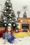 The little girl in the Christmas tree. Royalty Free Stock Photography