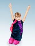 Little girl in a blue sundress Stock Photography