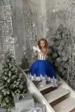 Little girl in a blue velvet dress Royalty Free Stock Photos