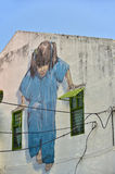 Little Girl in Blue on the wall. GEORGETOWN PENANG, MALAYSIA - JULY 30, 2015: Little Girl in Blue Painted wall mural by artist Ernest Zacharevic in George Town Stock Photo