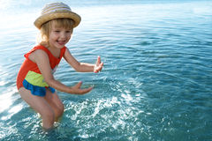 Little girl in blue water sea Royalty Free Stock Photography