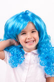 Little girl with blue wig Royalty Free Stock Images