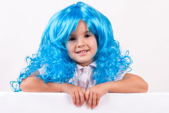 Little girl with blue wig Stock Photos