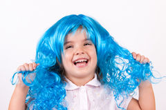 Little girl with blue wig Stock Photo