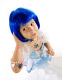 Little girl with blue wig. Little girl playing dress up with blue wig and jewelry Royalty Free Stock Image