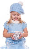 Little girl. In blue winter Christmas costume with Christmas toy in her hands Royalty Free Stock Photos