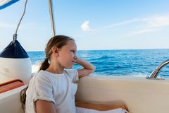 Little girl on boat. Adorable little girl on board of speedboat royalty free stock photo