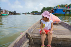 Little Girl on a boat ride in Hoi An, Vietnam. 