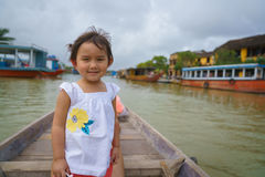 Little Girl on a boat ride in Hoi An, Vietnam. Photo taken on: January 10th, 2017 stock photos
