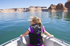 Little Girl on a boat ride at Lake Powell. A young girl looking out on the front of a boat at beautiful Lake Powell National Recreation Area Royalty Free Stock Photos