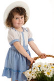 Little girl with bonnet. A little beautiful girl with bonnet, with a basket with flowers and toys Stock Image