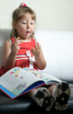 A little girl with a book Royalty Free Stock Photo