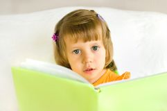 The little girl with the book Royalty Free Stock Photo